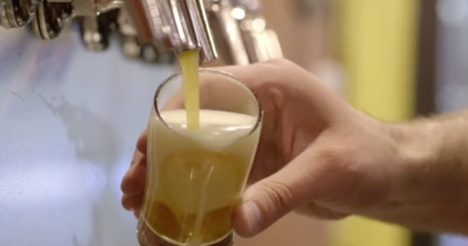 Greeley Unexpected Video, man's hand pouring ale